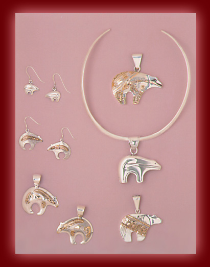 Sterling Silver and Gold Bear jewelry in Pendants, and Earrings.