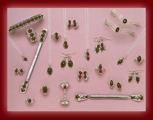 Bracelets, earrings, rings, bolas, pendants, necklaces, belt buckles, and watch bands made from Red Garnet and Sterling Silver settings.