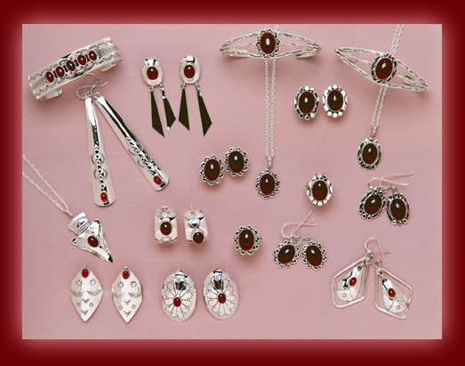 Bracelets, earrings, rings, bolas, pendants, and necklaces made from Red Garnet and Sterling Silver settings.