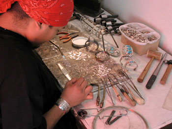 A Skystone Creations Native american indian jewelry silversmith's adds the finishing touches to one of our beautiful sterling silver jewelry and turquoise gemstone bracelets