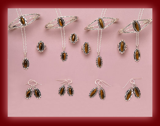 The gemstone Tiger Eye is mounted on silver jewelry settings of pendants, necklaces, earrings, rings, bolas, bracelets, belt buckles, and watch tips.